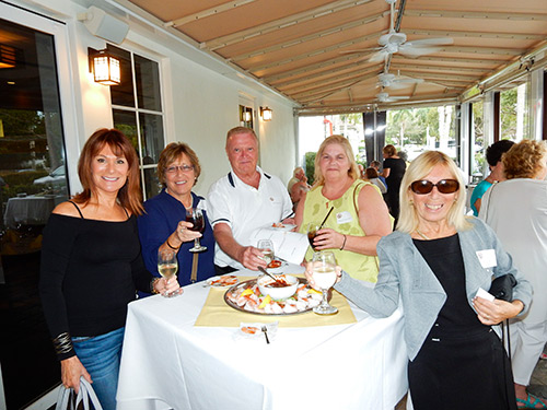 Alumni attend a reception event in Naples.