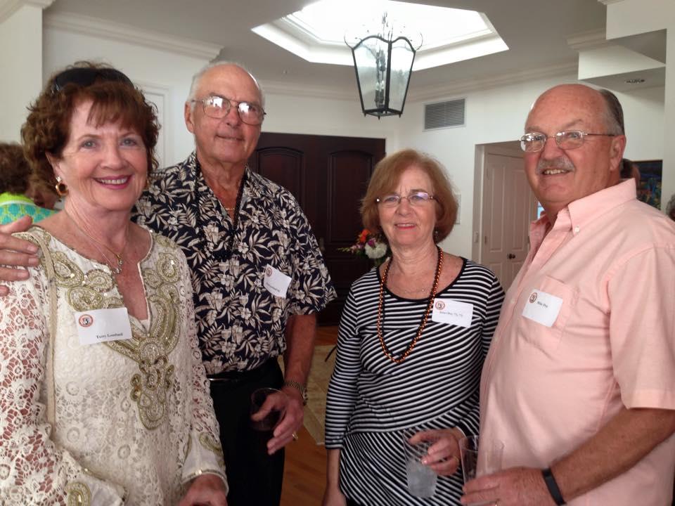 Alumni attend a reception event in Sarasota.